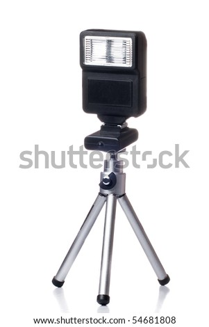 Small tripod with a flash for camera isolated over white background with synchronizer light - stock photo