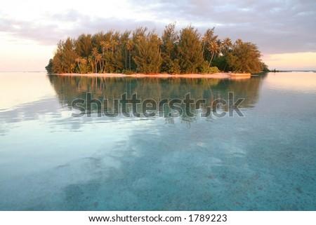 small tropical island at sunrise, Tahiti - stock photo