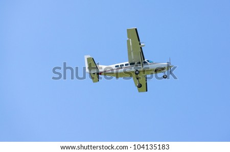 Small turboprop airplane in flight - stock photo