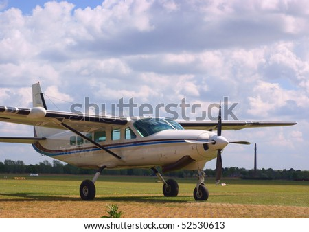 Small turboprop airplane, waiting for it;s next flight - stock photo