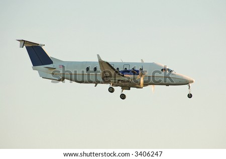 Small turboprop at sunrise - stock photo
