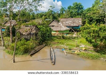 Small village in a peruvian jungle along Napo river - stock photo