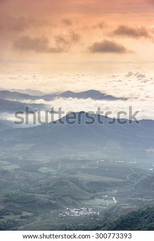 Small village in sea of cloud - stock photo
