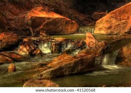 Small Virgin River water fall along the Riverside Walk in Zion National Park. - stock photo