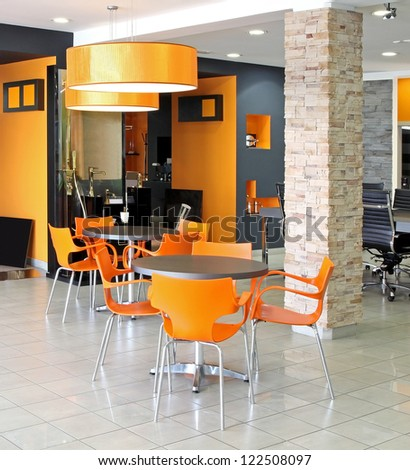 Small waiting area tables inside modern office space - stock photo