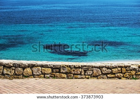 small wall by the shore in Sardinia, Italy - stock photo