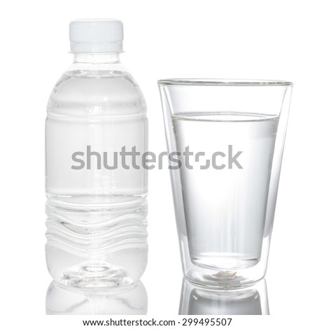 Small water bottle and double wall glass - stock photo