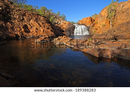Small waterfall and pool with clear water, Kakadu National Park, Australia - stock photo