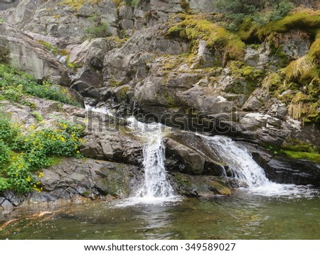Small waterfall at Avalanche Creek in Glacier National Park - stock photo