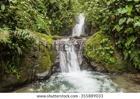 Small waterfall in Nambillo Cloud Forest Reserve near Mindo, Ecuador. - stock photo