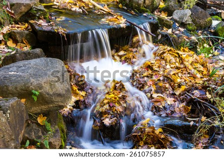 Small Waterfall in the park at St Helen's Island in Montreal in Autumn - stock photo