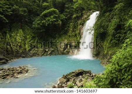 Small waterfall on the Rio Celeste in Costa Rica. - stock photo