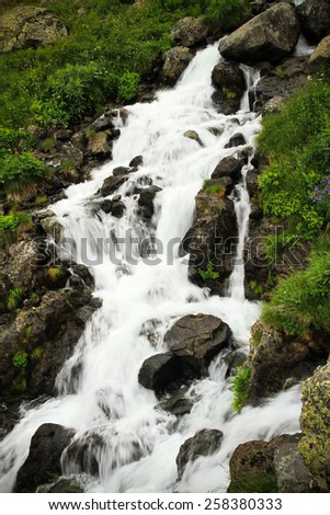 Small waterfall over rock slope. - stock photo