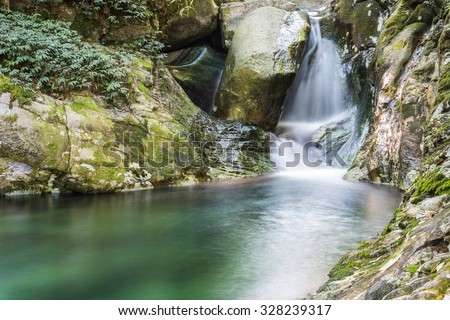 small waterfall with deep pool of  clear water in lushan , China - stock photo