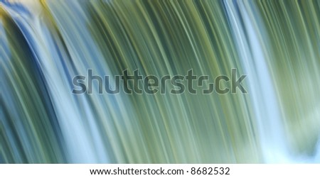 small waterfall with motion blur - stock photo