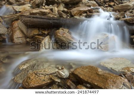 Small waterfalls in the himalayan valley - Nepal, Himalayas  - stock photo