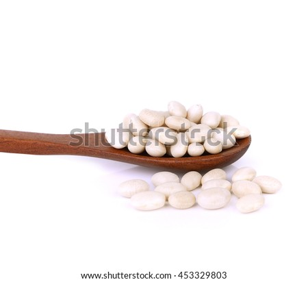 Small white beans, haricot, white pea, white kidney or Cannellini Purgatorio beans in wooden spoon on white background. - stock photo