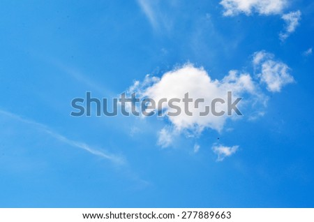 Small white clouds on blue sky - stock photo