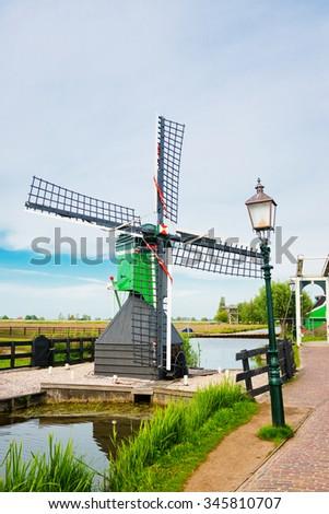 small windmill in  the Zaanse Schans (near Amsterdam)  - stock photo