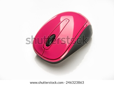 Small wireless pink mouse for portable laptop - stock photo