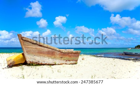 Small wooden boat on caribbean beach in Dominican Republic - stock photo