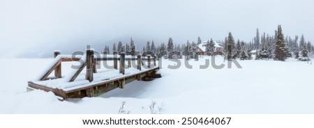 Small Wooden Bridge and Snow Landscape - stock photo