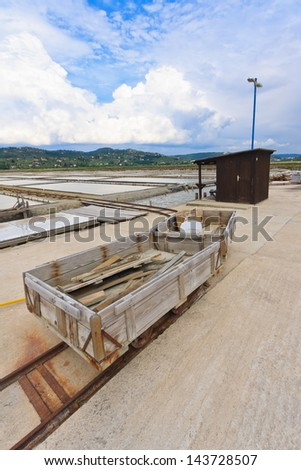 Small wooden carts and the track at salt fields in Se?ovlje, Slovenia - stock photo