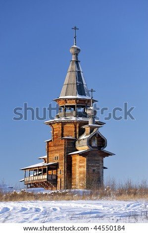Small wooden church, winter, clear sky at background - stock photo