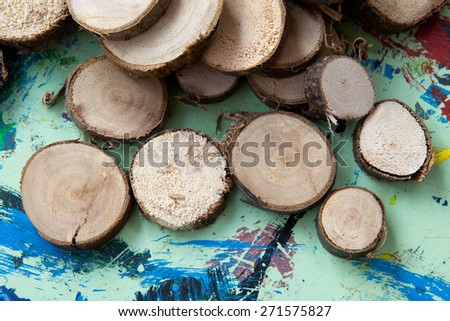small wooden discs on the painting table - stock photo