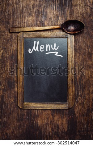 Small wooden framed blackboard with text - Menu.  Top view - stock photo