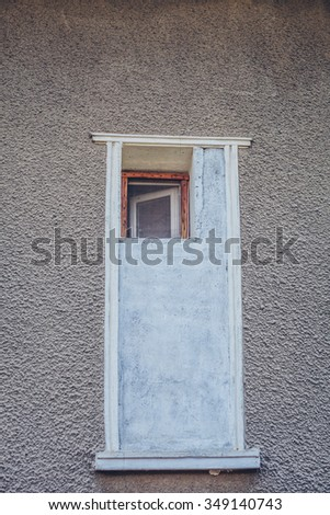 Small wooden window, part of a big walled window - stock photo