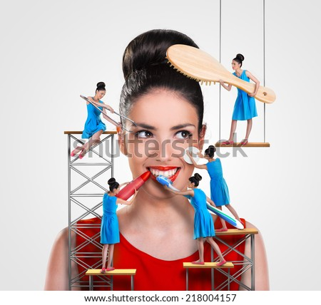 Small workers working on a beautiful woman - stock photo