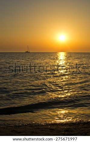 Small yacht at sunset near Sani resort in Greece - stock photo