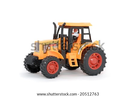 Small yellow toy tractor isolated on white - stock photo