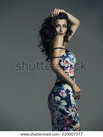 Smart adult woman in the pose of temptation  - stock photo