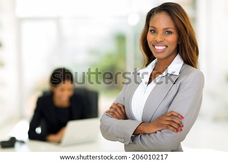 smart african business woman in office - stock photo