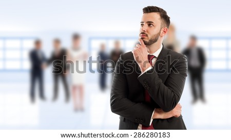 Smart and young business man thinking on business people background - stock photo
