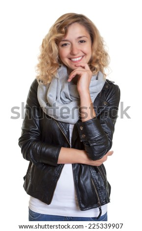 Smart blond woman in a leather jacket - stock photo