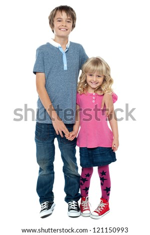 Smart boy holding cute sisters hand and embracing her. Reflects great love and affection. - stock photo