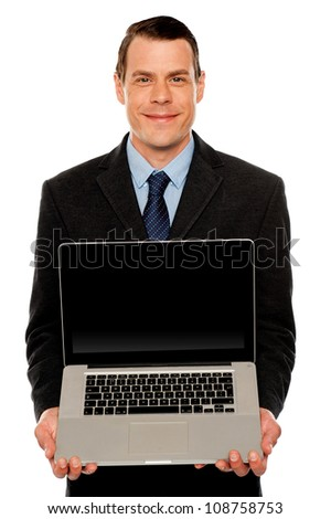 Smart businessman displaying laptop to you. All on white background - stock photo
