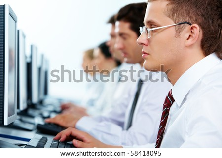 Smart businessmen typing in line at workplaces - stock photo