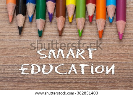 Smart Education words - Concept frame of multicolored pensils on wood background - stock photo