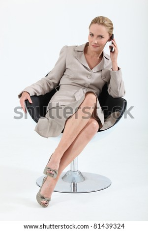 Smart executive woman using a telephone - stock photo