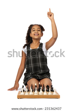 smart girl playing chess raised thumbs up. have an idea - stock photo