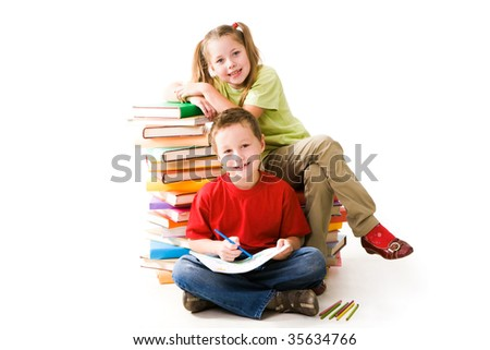 Smart girl sitting on book pile and cute schoolboy looking at camera - stock photo
