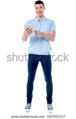 Smart guy browsing on his new tablet pc - stock photo