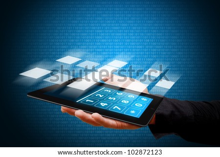 Smart hand and digital touch pad - stock photo