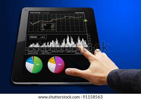 Smart hand touch Digital Tablet with graph report - stock photo