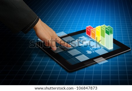 Smart hand touch on digital touch pad with graph - stock photo