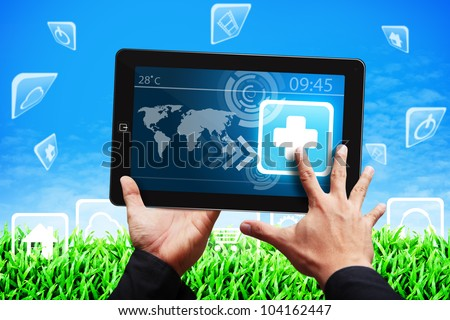 Smart hand touch on First aid icon on tablet pc - stock photo